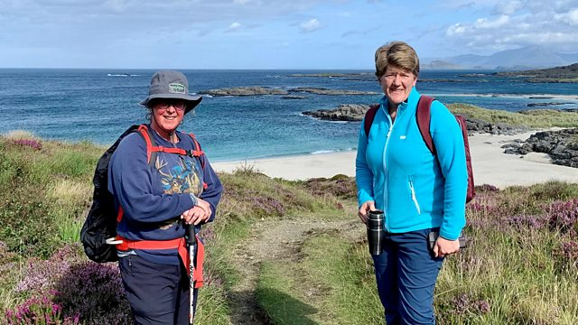 Dee and Claire walking on the Ardnamurchan Peninsula. White sands, turquoise seas and clear blue skies.