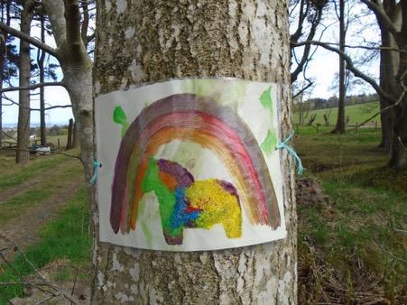 Children's artwork: painting of rainbow & pony, tied to tree