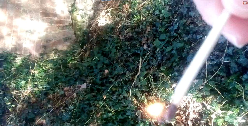 A lighted match is struck at the site of a lost medieval gate in Sandwich, UK.