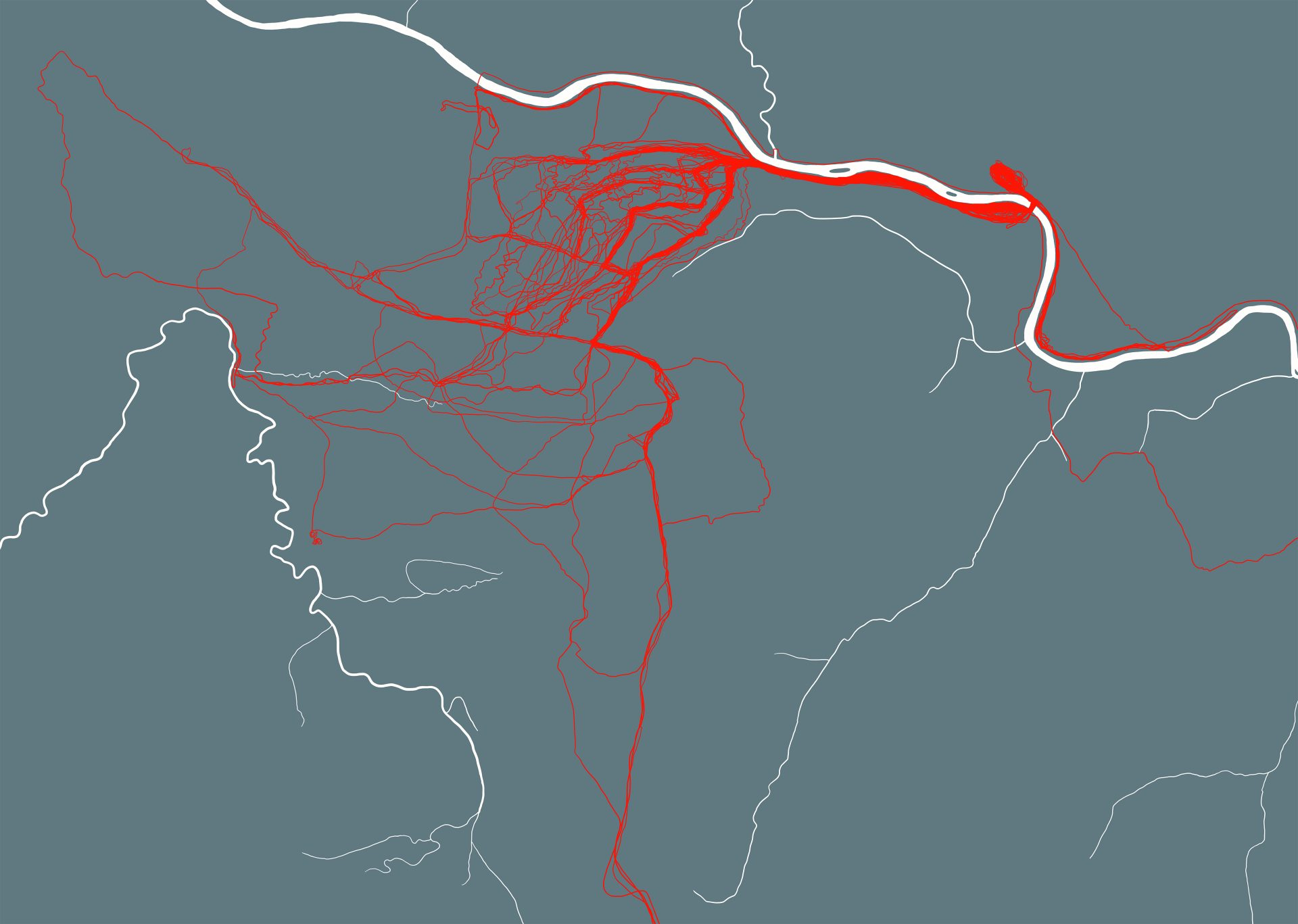The image shows an abstract map with white lines on a blue-grey background and a series of layered red lines over the top.
